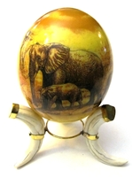 Decoupage African Animals drawing Ostrich egg with warthog tusk